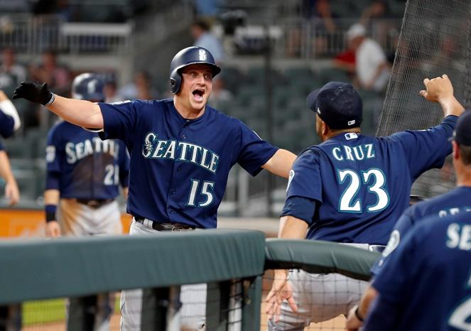 Seattle Mariners' Kyle Seager celebrates with Nelson Cruz after hitting a three-run home run in the eighth inning against the Atlanta Braves Wednesday, Aug. 23, 2017, in Atlanta.