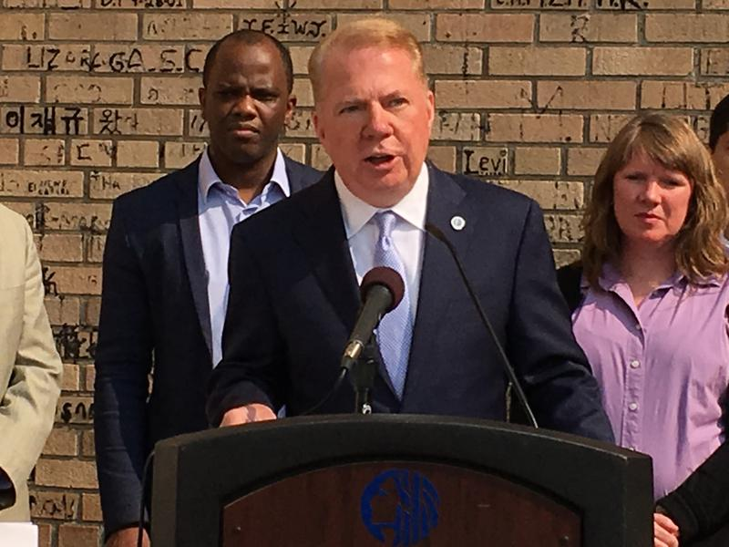 Seattle Mayor Ed Murray announces Defense Fund grantees. Issa Ndiaye, with the West African Community Council, and Juliann Bildhauer, with Kids in Need of Defense, represent organizations that will receive funds.