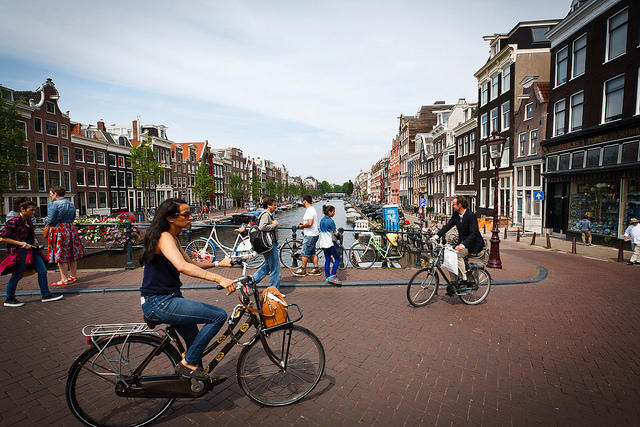 People ride bikes in Amsterdam.