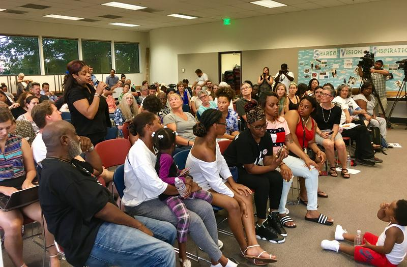 Community members talk about recent police-involved shootings in King County at an August public forum in Seattle's Central District.