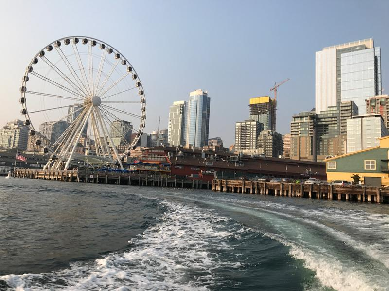 Leaving Seattle's waterfront aboard KNKX travel expert Matthew Brumley's boat on a sunny -- and slightly smoky -- Thursday evening in August.