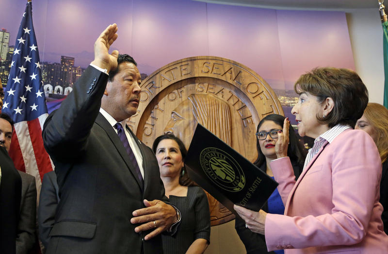 Seattle City Council President Bruce Harrell is sworn in as mayor by City Clerk Monica Martinez Simmons Wednesday Sept. 13, 2017, at Seattle City Hall.