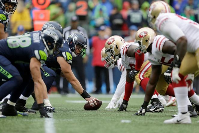 Seahawks center Justin Britt, left, lines up with teammates against the San Francisco 49ers on the line of scrimmage, Sunday, Sept. 17, 2017, in Seattle.