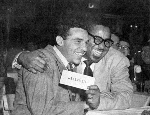 Buddy Rich & Dizzy Gillespie (neither known for being reserved) in an undated photo by unknown photographer.