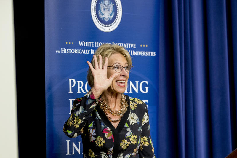 Education Secretary Betsy DeVos waves as she steps away from the podium after speaking at the White House Summit on Historically Black Colleges and Universities on Sept. 18, 2017, in Washington, D.C.