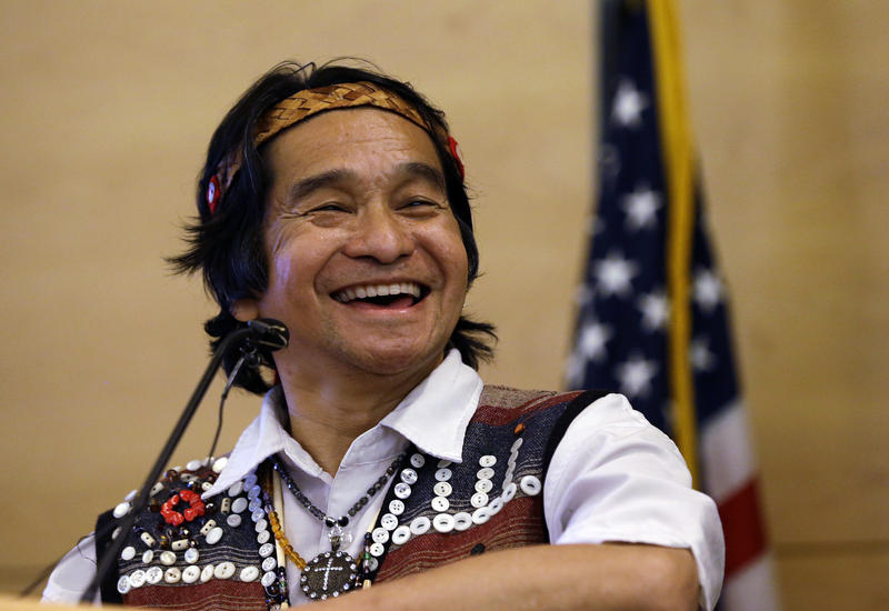 Johnny Moses, a member of the Tulalip Tribe, smiles as he speaks before a signing ceremony for a resolution designating Indigenous Peoples Day in Seattle, in 2014.
