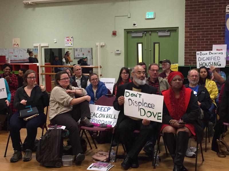 "Community members in the Beacon Hill neighborhood showed up at a public meeting to support Esther ""Little Dove"" John, whose apartment building is slated to be torn down and redeveloped."