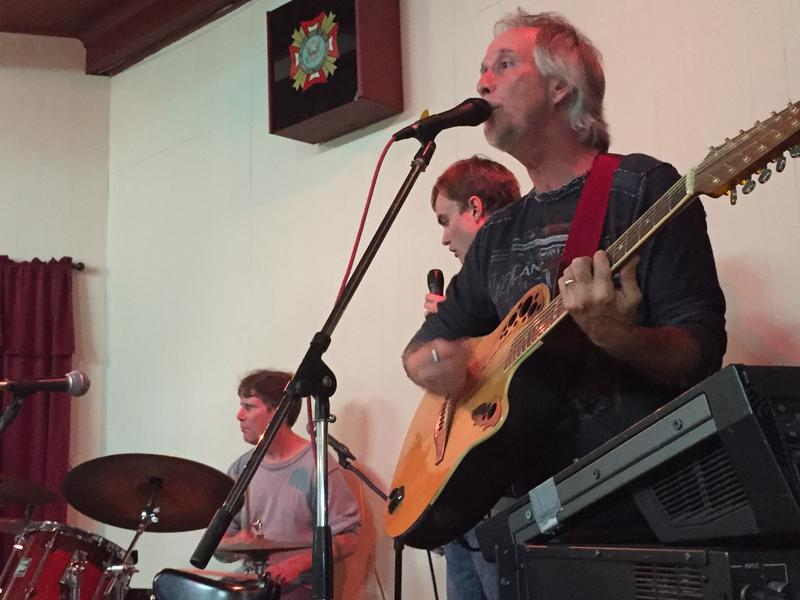 Jon Delgarn, the creator of Out Of The Ashes, playing with the band at the VFW Hall in Bellingham, Washington.