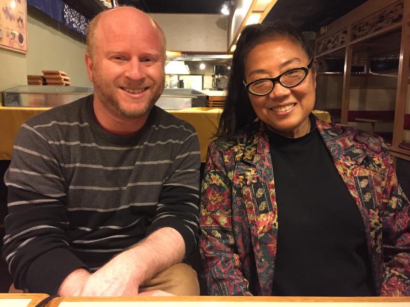 Gabriel Spitzer and Karen Sakata, at Bush Garden Karaoke Bar in Seattle's International District. Sakata co-owns the bar with her husband.