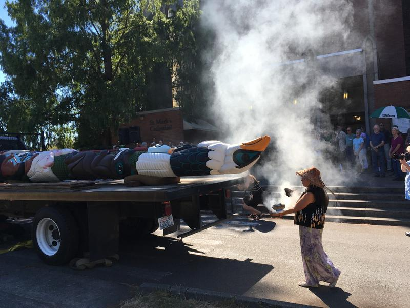 A smudge ceremony with sage and eagle feathers, performed by  Linda Soriano of the Lummi Nation outside Seattle's St. Marks Cathedral in the 2016 Lummi Totem Pole Journey, which also took aim at fossil fuel developments.