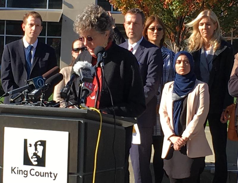 Burien City Councilwoman Nancy Tosta speaks out, along with other leaders, against flyers mapping names and addresses of alleged undocumented criminals.