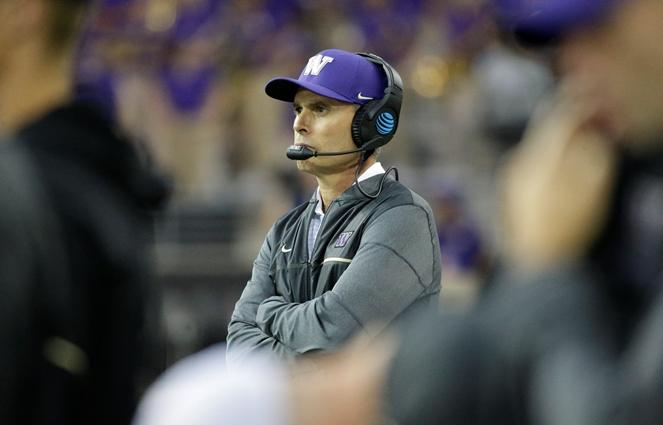 UW head football coach Chris Petersen watches from the sideline during a game against Montana, Saturday, Sept. 9, 2017, in Seattle. Washington won 63-7.