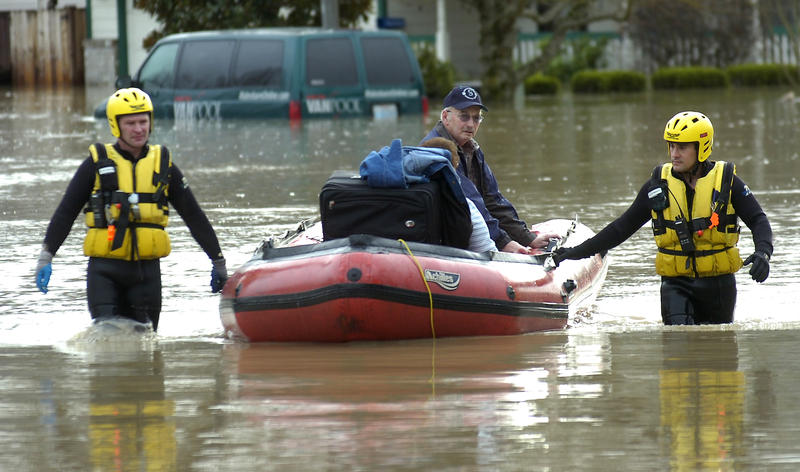 Valley Regional Fire Authority personnel rescue a couple from their flooded home at White River Estates, in Pacific, on Jan. 9, 2009.