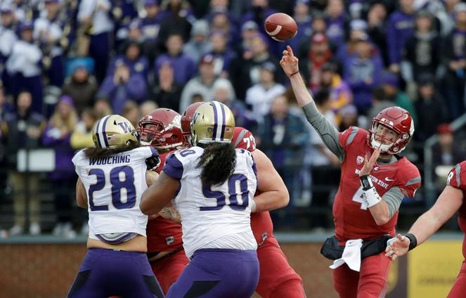 WSU quarterback Luke Falk passes against Washington in the 2016 Apple Cup game in Pullman, Wash., Nov. 25, 2016.  Washington beat Washington State 45-17. There's a chance both teams will be undefeated in this year's matchup.