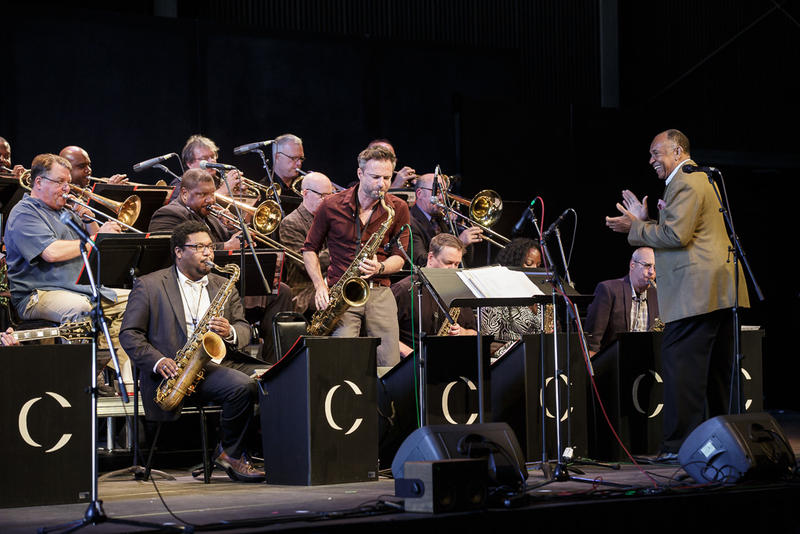 Saxophonist Adrian Cunningham solos with the Jazz Port Townsend All Star Big Band, John Clayton conducting.