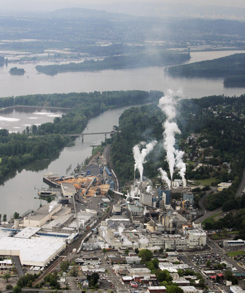 Steam rises from the Georgia-Pacific Corp. paper mill next to the Columbia River in Camas, Wash.,  in this May 12, 2005 file photo. Climate change in Washington state has the potential to affect both industry and the environment in the future.