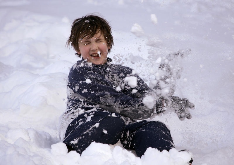 Max Kleweno, 9, of Lake Forest Park, Wash., tries to deflect a snowball thrown at him as he plays in the snow, Wednesday, March 31, 2010, at Stevens Pass, Wash. The ski area is open again this weekend, as are most others in the Cascades.