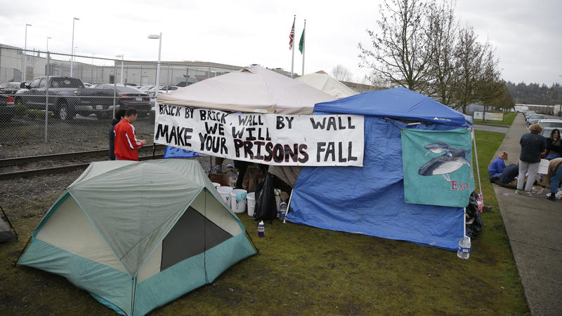 Activists gather in tents outside the Northwest Detention Center in Tacoma on April 12, 2017