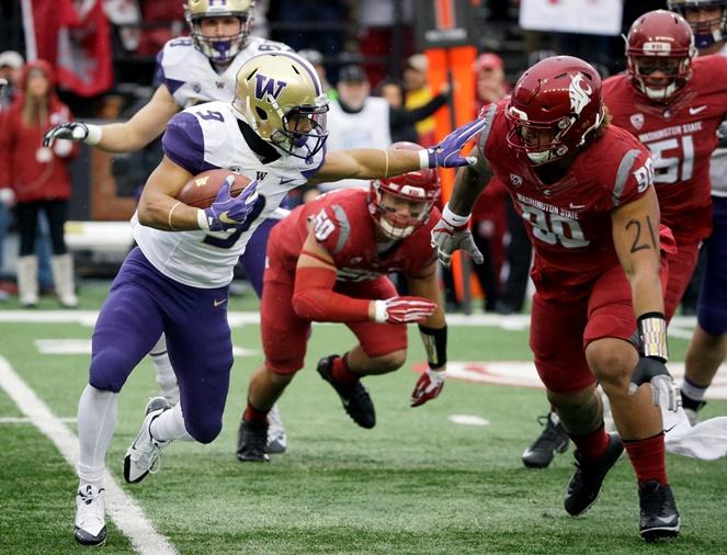 Washington running back Myles Gaskin (9) runs off Washington State defensive lineman Daniel Ekuale (90) in the first half of last year's Apple Cup game, Friday, Nov. 25, 2016, in Pullman, Wash.