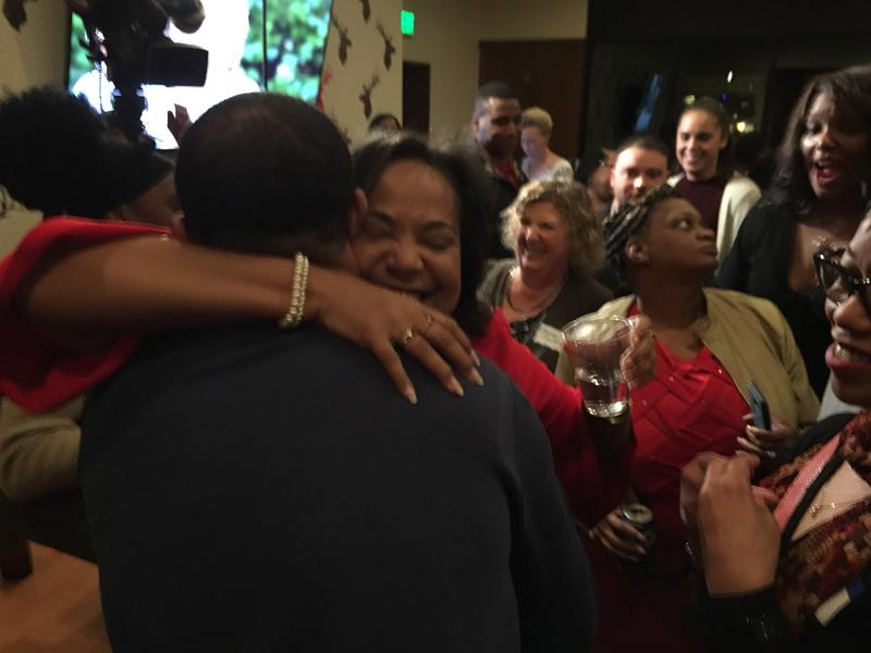 Victoria Woodards hugs a campaign supporter Tuesday night after getting an early lead in Tacoma's mayoral race.