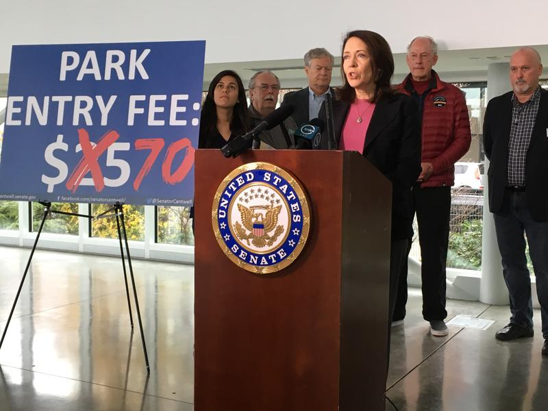 Washington Senator Maria Cantwell, flanked by outdoor enthusiasts supporting her opposition to the proposed increase in visitor fees at the nation's most popular national parks, in Seattle on Nov. 20, 2017. Michelle Pinon is on the far left.