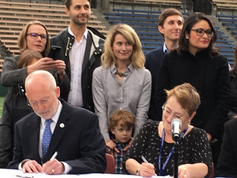 Seattle Mayor Tim Burgess and Leslie Harris, Seattle School Board Director, sign agreement to work on Memorial Stadium renovation and other district facility projects.