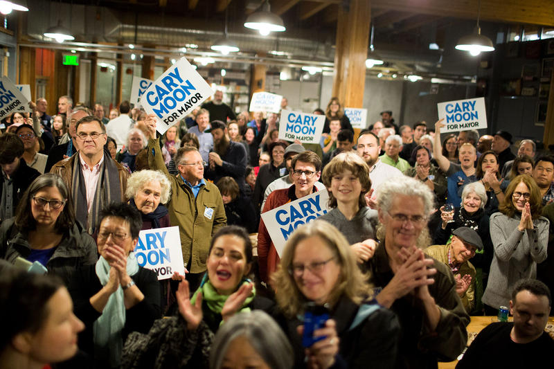 Cary Moon supporters gather at a party at Pike Place Market for the Seattle mayoral candidate shortly before the first ballot return comes down Tuesday evening.