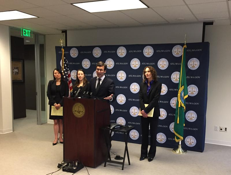 Washington State Attorney General Bob Ferguson, with members of his office's Consumer Protection Division, announces a lawsuit against Uber on Nov. 28, 2017