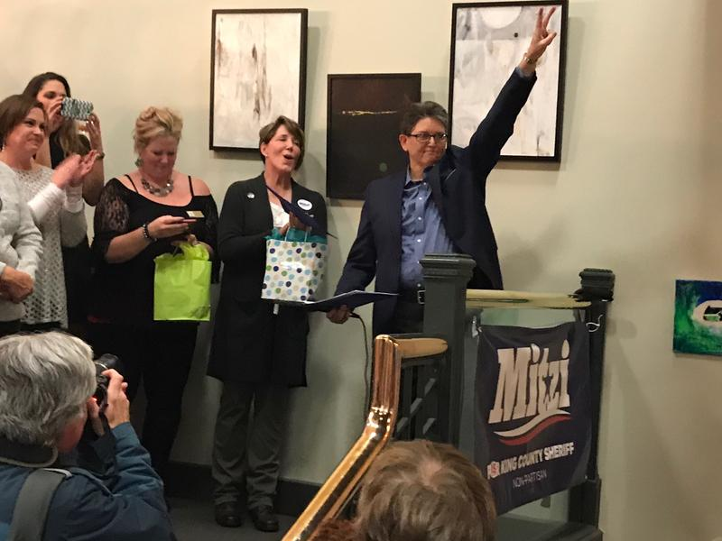 Challenger Mitzi Johanknecht celebrates her early lead over incumbent King County Sheriff John Urquhart Tuesday evening. She continued to widen her lead Thursday.