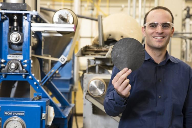 """Anthony Dichiara, a University of Washington professor in the School of Environmental and Forest Sciences holds a piece of """"smart"""" paper."""