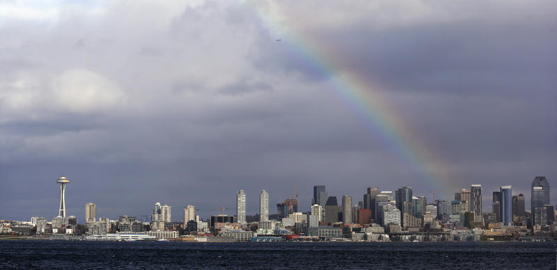 A rainbow briefly lights up over downtown Seattle and the Space Needle between rain and windstorms Monday, Nov. 13, 2017, in Seattle.