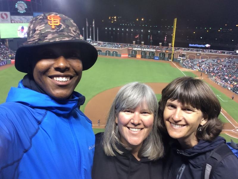 Darren, Carrie and Christine enjoying a baseball game, as a family.