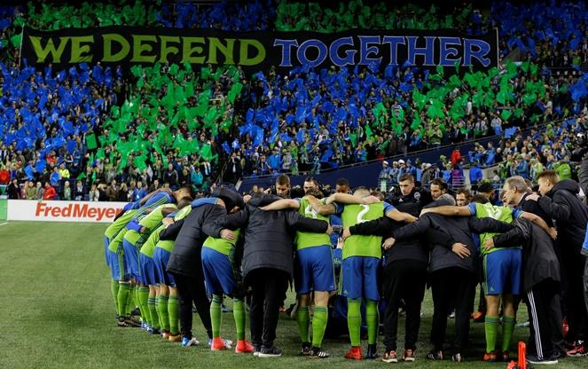 Seattle Sounders players huddle with coach Brian Schmetzer before the second leg of the MLS soccer Western Conference final between the Sounders and the Houston Dynamo on Thursday, Nov. 30, 2017, in Seattle.