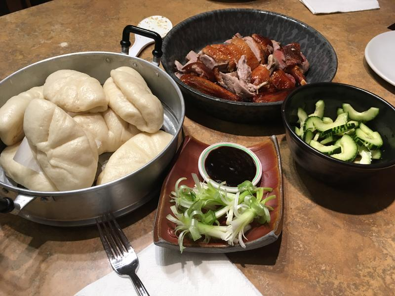 This.  From L: Steamed duck buns, beer roast duck, speed pickles, green onion brushs & hoisin sauce