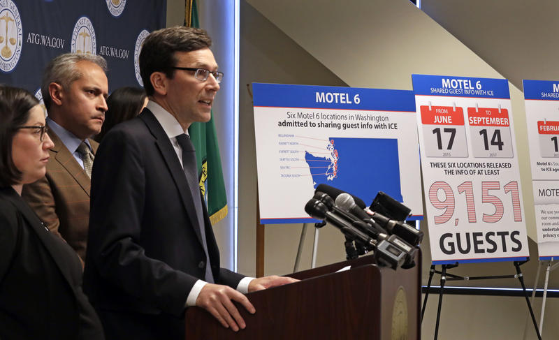 Washington state Attorney General Bob Ferguson addresses a news conference Wednesday, Jan. 3, 2018, in Seattle, announcing that his office is suing Motel 6, alleging the chain released guest information to U.S. immigration authorities.