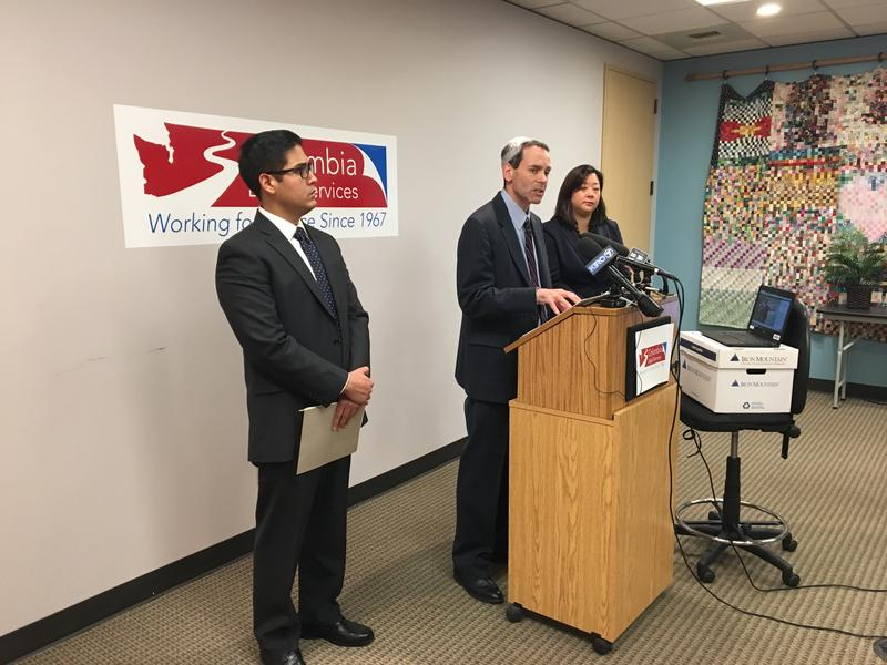 Joe Morrison (center), an attorney with Columbia Legal Services, at a news conference in Seattle on Jan. 25, 2018