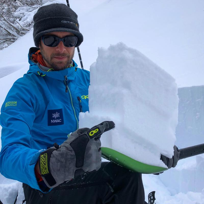 Forecaster Dallas Glass, highlighting potential avalanche layers in new storm snow.