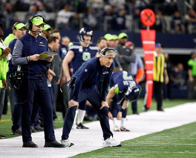 Seahawks head coach Pete Carroll looks toward the field from the sideline while playing the Dallas Cowboys during an NFL football game, Sunday, Dec. 24, 2017, in Arlington, Texas.
