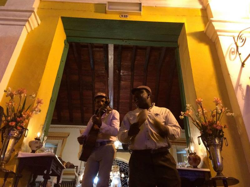 Musicians perform on the front steps of a restaurant in Trinidad, Cuba. Whether it's music, food, or just a different place -- travel can give us new experiences that leave us changed, says KNKX travel expert Matthew Brumley.
