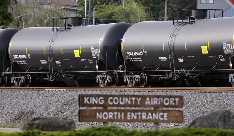 In this 2015 file photo, cars from one of two mile-long oil trains are parked near the King County Airport in Seattle. More crude oil than ever is expected in Washington state, particularly since Canada approved Kinder Morgan's TransMountain pipeline.