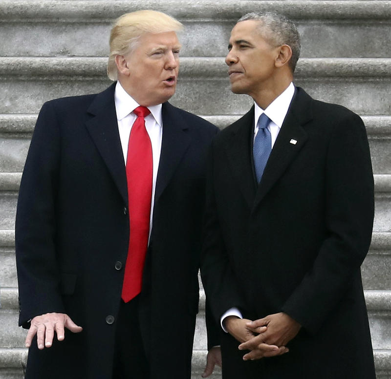 In this Friday, Jan. 20, 2017, file photo, President Donald Trump talks with former President Barack Obama on Capitol Hill in Washington, prior to Obama's departure to Andrews Air Force Base, Md.