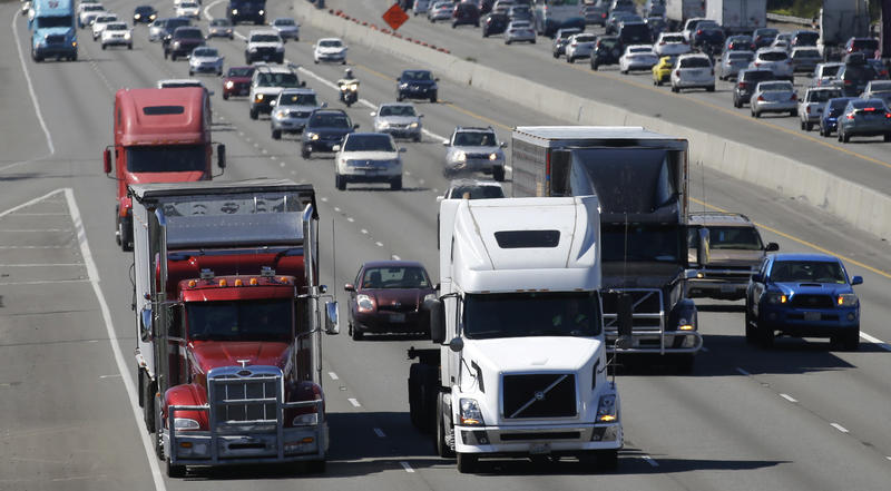 In this Aug. 24, 2016, file photo, truck and automobile traffic mix on Interstate 5, headed north through Fife, Wash., near the Port of Tacoma.