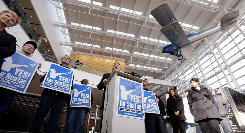 In this 2013 file photo, labor leader David Rolf declares victory after the $15 minimum wage for Sea-Tac Airport workers was approved by voters.
