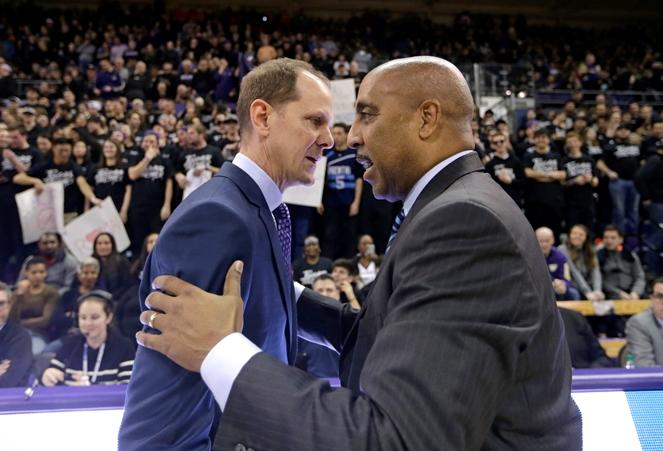 Washington head coach Mike Hopkins, right, greets Arizona associate head coach Lorenzo Romar before an NCAA college basketball game Saturday, Feb. 3, 2018, in Seattle. Romar is the former Washington head coach returning for the first time.