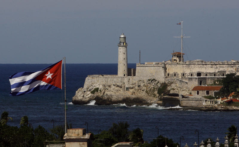 A Cuban flag waves in front of El Morro Castle in Havana, 2008