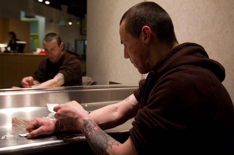 A man injects heroin at North America's first safe-injection clinic in Vancouver, B.C., in 2011
