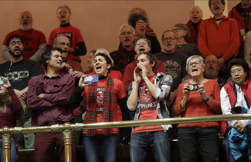 "Environmental protestors shout ""We have a climate crisis!"" from the public gallery of the state Senate, Monday, Jan. 8, 2018, in Olympia, Wash. Despite the urgency felt by many, no major climate policies passed during the special session that ended Thurs."