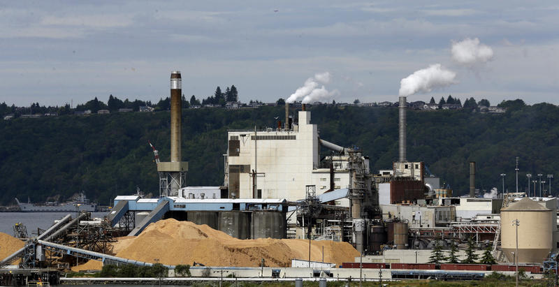 In this 2016, file photo, piles of wood chips sit near the RockTenn paper mill in Tacoma, Wash. Another ambitious effort to pass a carbon tax in Washington state has faltered as both Gov. Jay Inslee and the bill's prime sponsor conceded Thursday.