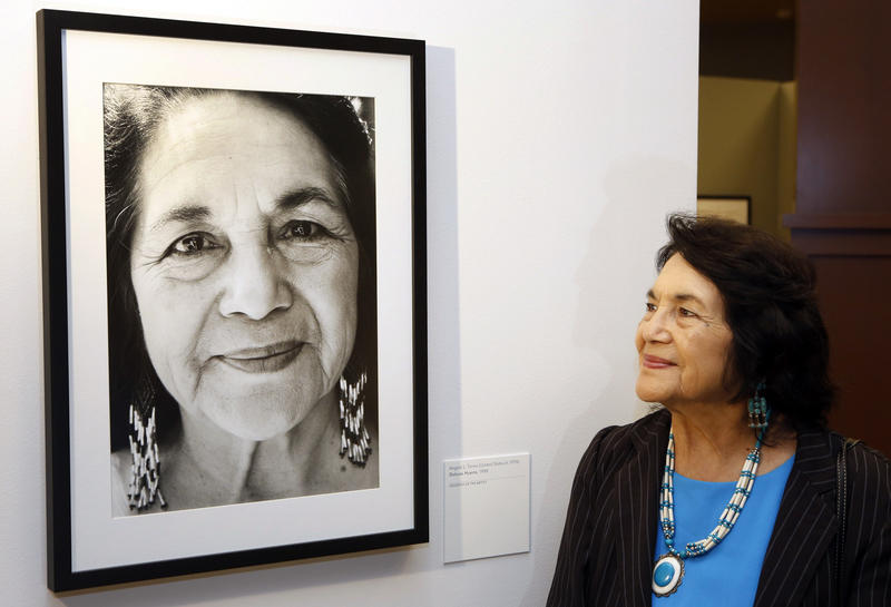 "In this April 10, 2014, file photo, Dolores Huerta stands by a portrait of herself taken in 1998 by photographer Angela Torres, as she tours her exhibition, ""Viva la Causa! Dolores Huerta and the Struggle for Justice,"" in Los Angeles."