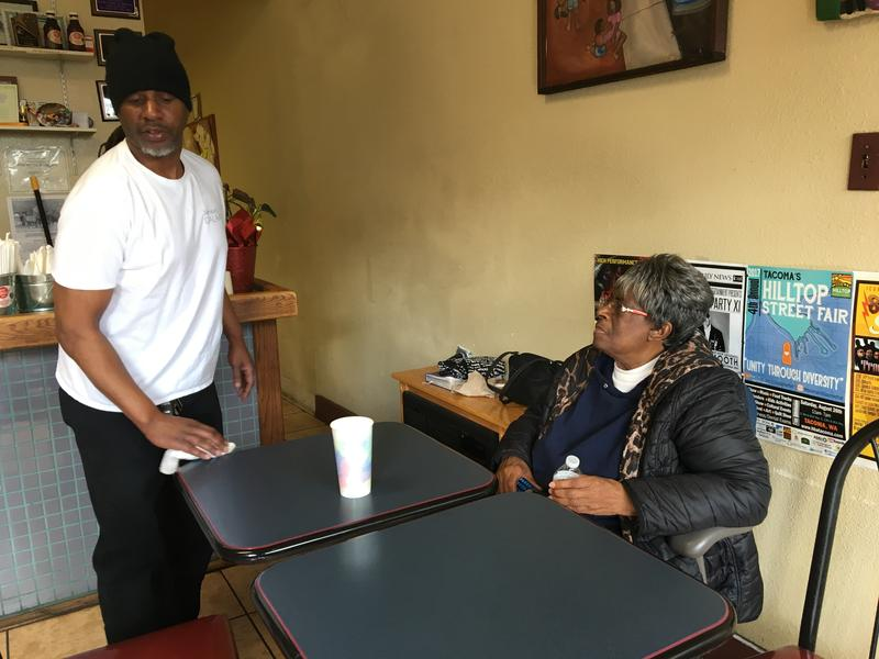 Jonathan Clark cleans up after the midday lunch rush while his mother, Carolyn Littles, looks on